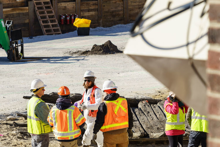 Rear view of construction workers
