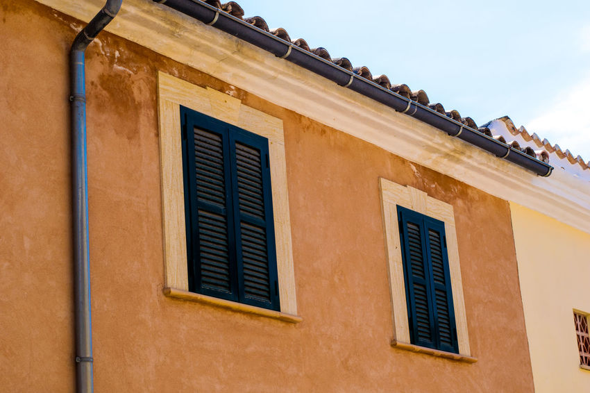 Architecture Building Exterior Built Structure City Day Drainpipe House Low Angle View Majorca Mallorca No People Outdoors Residential Building Shutters Sky SPAIN Window Andratx