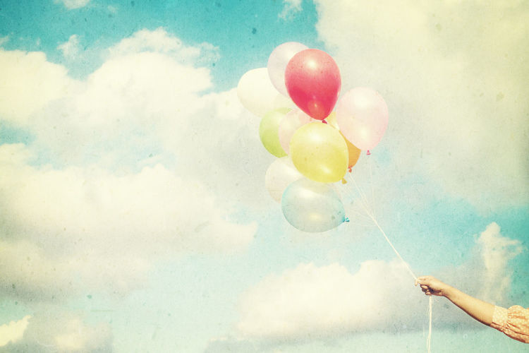 Girl hand holding multicolored balloons done with a retro vintage instagram filter effect, concept of happy birth day in summer and wedding honeymoon party (Vintage color tone paper texture) Balloon Human Hand Holding Cloud - Sky Hand Real People One Person Human Body Part Sky Multi Colored Nature Unrecognizable Person Day Body Part Finger Human Finger Lifestyles Outdoors Celebration Vintage Old-fashioned Summer Celebration Balloons Art