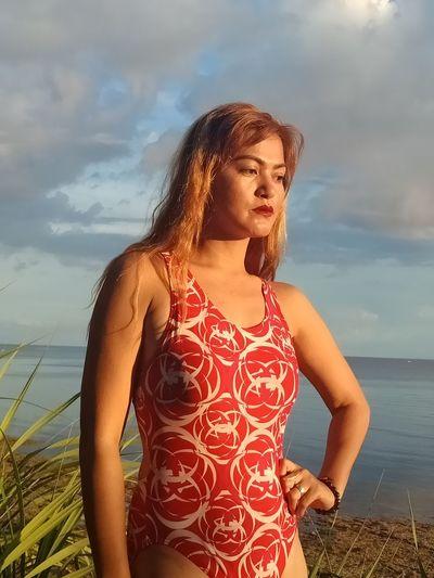 EyeEm Selects Water Young Women Sea Portrait Beach Women Sunset Beauty Standing Red Dramatic Sky Atmospheric Mood Romantic Sky Wet Hair Sundress Shore