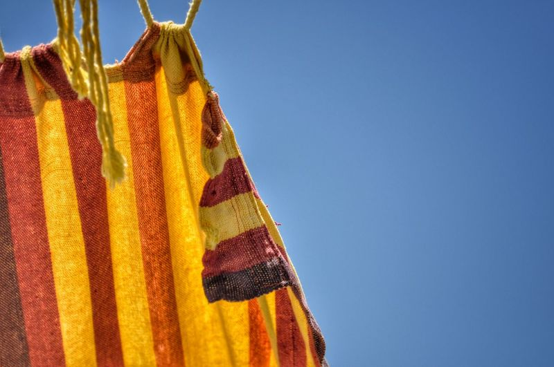 Curtain Hanging Against Clear Blue Sky