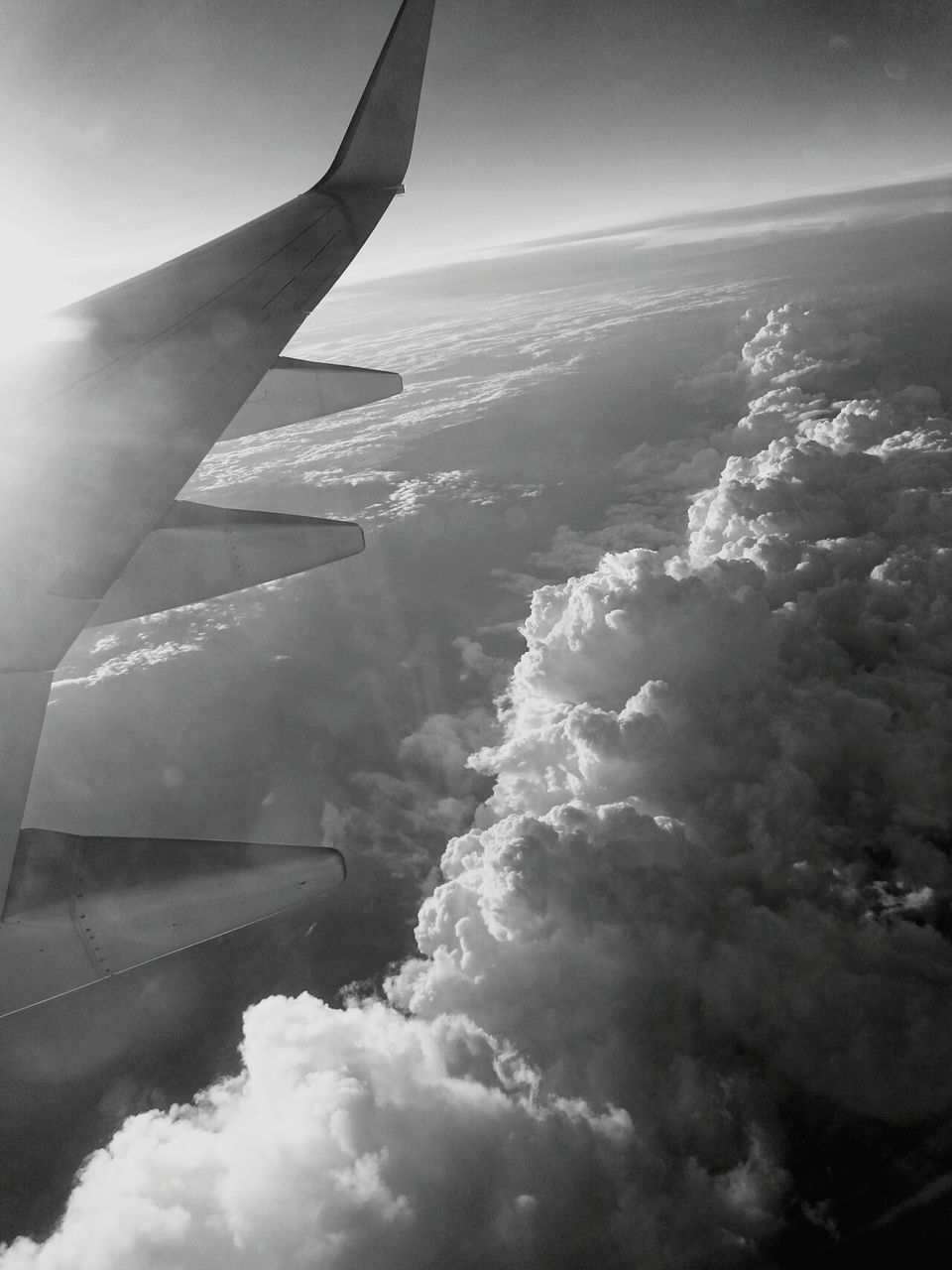 journey, transportation, airplane, airplane wing, aerial view, sky, nature, travel, cloud - sky, no people, aircraft wing, beauty in nature, outdoors, day, scenics, air vehicle, landscape, adventure, vehicle part, flying, the natural world