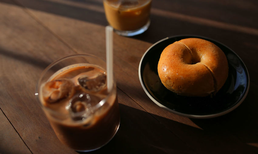 Donut on wooden table. Drink Food And Drink Table Food Glass Close-up Still Life Baked Focus On Foreground Indoors  Freshness Donuts🍩
