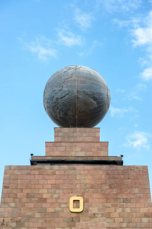 Large metal globe on the top of the monument to the equator in Quito, Ecuador America Architecture Building Center Culture Destination Earth Ecuador Equator Exterior Famous Global Globe Latitude LINE Longitude Middle Mitad Del Mundo Monument Outodoors Quito South Tourism Travel World