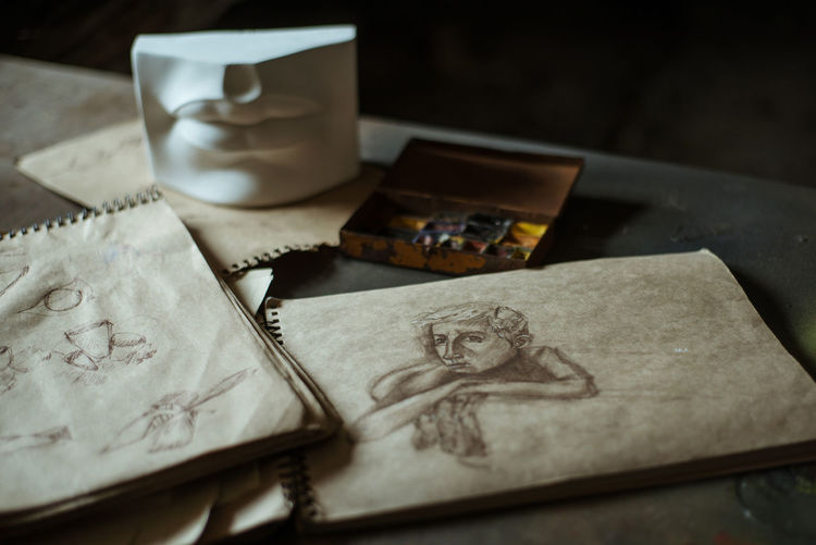 Still Life Indoors  No People Table Close-up Paper Human Representation Art Arts Culture And Entertainment Art And Craft ArtWork Artist Gallery Paint Painting Painting Art Portrait Drawing Draw Sketch Sketchbook Sketching