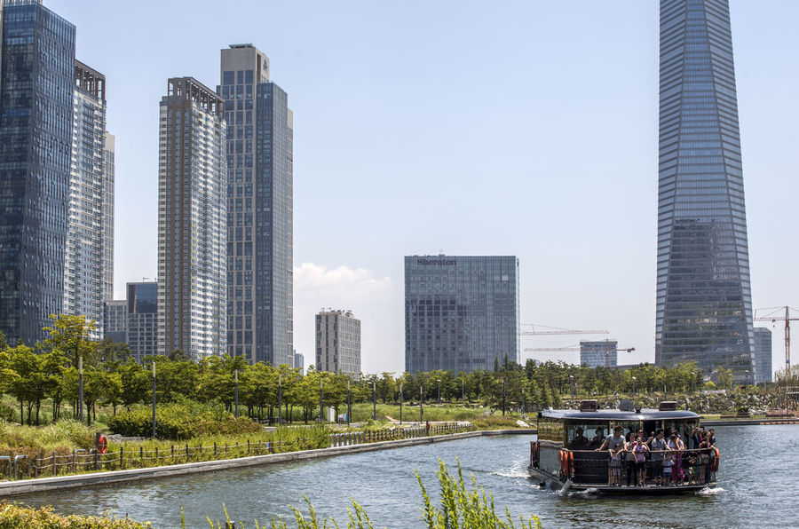 Architecture Boat Building Building Exterior Built Structure Capital Cities  Central Park City City Life Cityscape Day Modern Office Building Outdoors River Sky Skyline Skyscraper Tall Tourist Tower Tree Urban Skyline Water Waterfront
