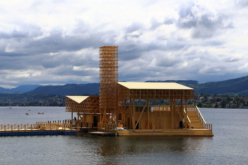 "Assembly of the ""Pavillon of Reflections"" on Lake Zurich. Central presentation platform of the Manifesta 11, the European Biennial of Contemporary Art. Architecture Architecture_collection Architecturelovers Blue Built Structure City Cityscapes Construction Contemporary Contemporary Art Europe Lake Manifesta 11 Modern Architecture Modern Art Sky Sky And Clouds Skyline Switzerland Minimalist Architecture Tourism Travel Water Wood Zürich"