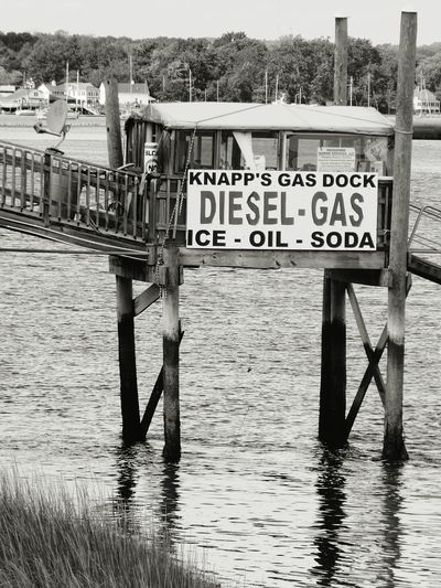 Monochrome Photography Water Built Structure Waterfront Outdoors Wooden Pier Text Communication Western Script Rippled Sea Day No People EyeEm Best Shots - Black + White Eye For Photography Ey