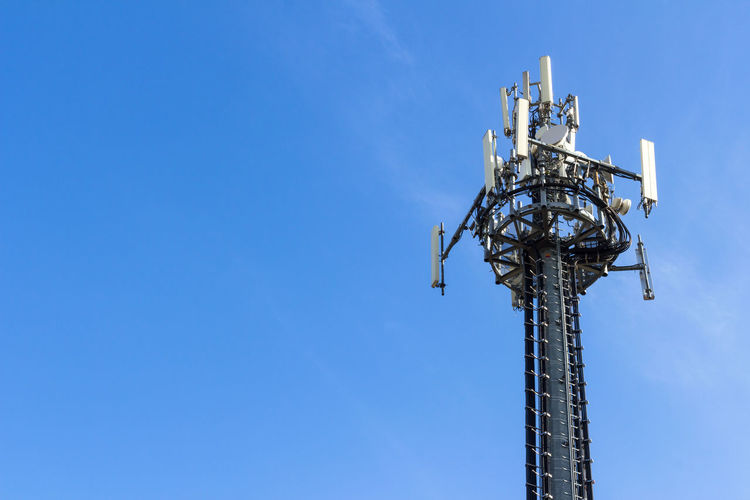Telecommunication tower on blue sky background Industry Pylon Radio Signal Station Antenna Blue Broadcasting Cell Cellular Communication Connection Equipment Global Mast Microwave Mobile Network Phone Receiver Satellite Sky Steel Structure Technology
