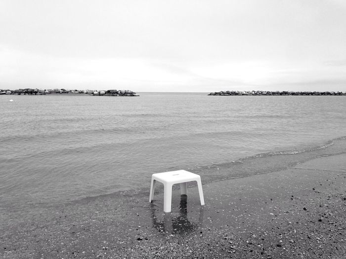 The Journey Is The Destination reaching the East Coast finding a place ready for the tired souls 👣👣👣 Sofiavicchi Sofiavicchiconceptdesign Lonely Seat Chair Seaside Sea Beach Beachphotography Bnw Bnw_collection Landscape Landscape_photography