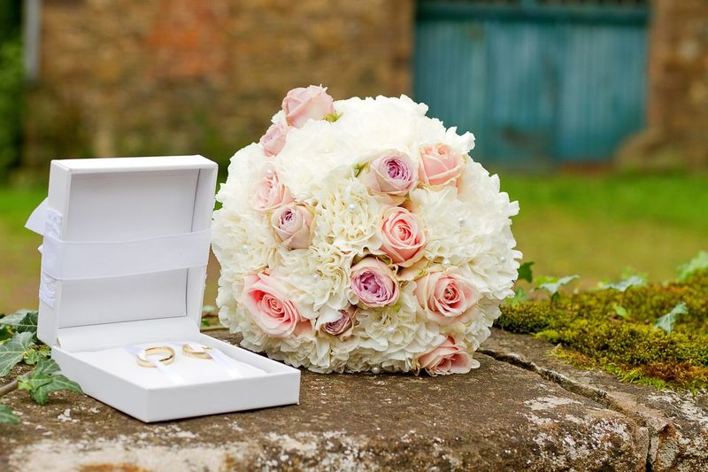 Rose bouquet by rings on retaining wall