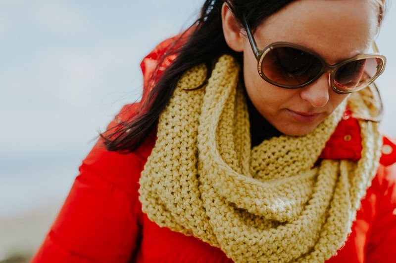 Close-up of woman with sunglasses against sky