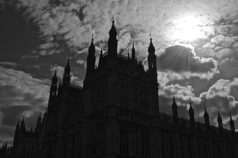 Palace Of Westminster Against Cloudy Sky On Sunny Day