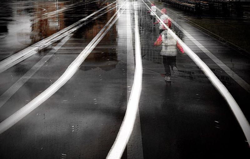 Man walking on wet road in rainy season