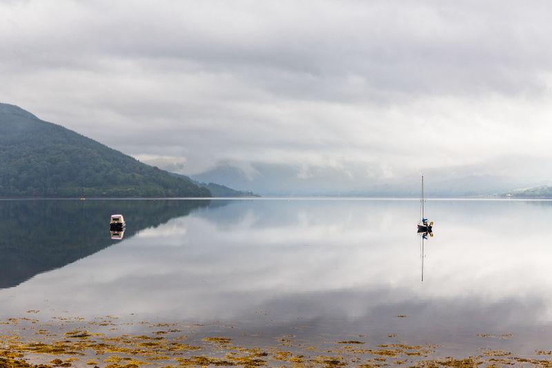 Boat near the shores of loch fyne, scotland.