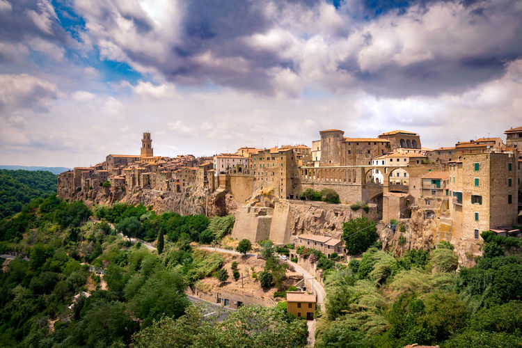 Panorama of Pitigliano, a town built on a tuff rock, one of the most beautiful villages in Italy. Amazing Antique Architecture Authentic Beautiful Cityscape Etruscan Italy Landmark Medieval Medieval Town Old Town Panorama Panoramic Picturesque Pitigliano Renaissance Romantic Scenery Sunset Tufa Rock Tuff Tuscany Unesco Village World Heritage