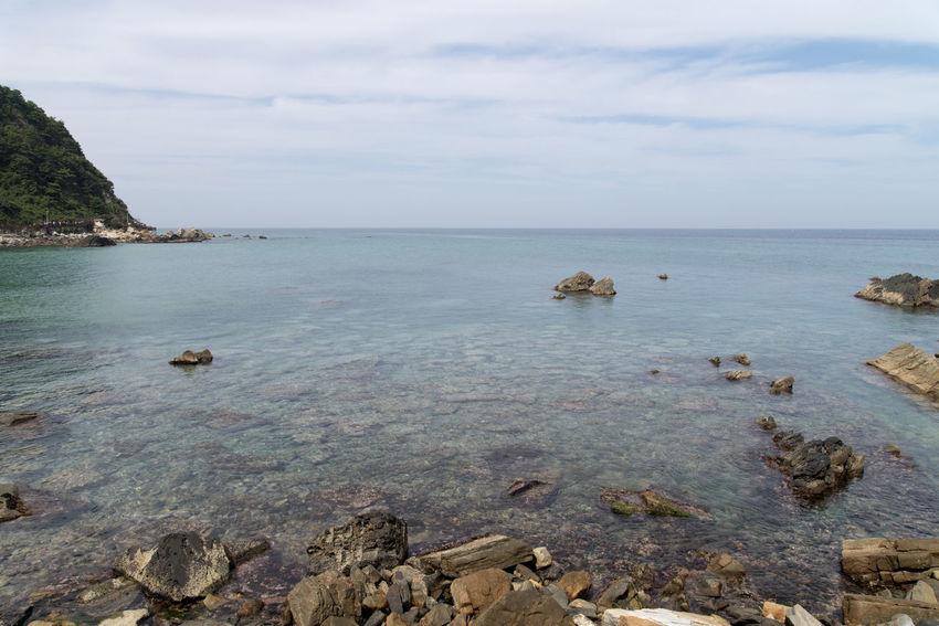 """famous seaside called """"Badabuchaegil"""" at Jeongjdongjin in Gangreung, Gaongwondo, South Korea Badabuchaegil Gangreung Jeongdongjin Beach Beauty In Nature Day Horizon Over Water Nature No People Outdoors Rock - Object Scenics Sea Seaside Sky Tranquil Scene Tranquility Water"""