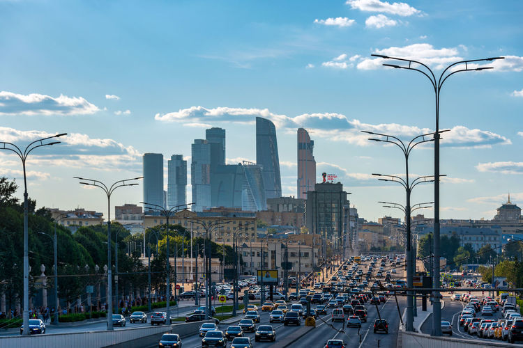 "View of the Skyscraper financial district of Moscow city with the infamous Moscow traffic in the foreground. A small sign of ""Russia 2018"" FIFA championship makes the image contemporary Moscow City Russia Traffic Architecture Business District City Cityscape Cloud - Sky Famous Place Financial District  Modern No People Skyscraper Street Street Light Streetphotography Tall - High Tower Urban"