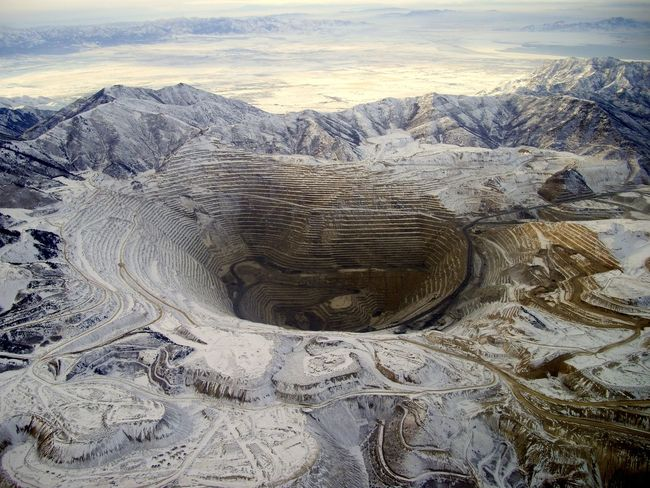 This has been one of my most popular photos here and elsewhere. It's of the Bingham Canyon Coper Mine, more commonly known as Kennecott Copper Mine near Salt Lake City Utah. It's the largest excavation in the world. It's .6 miles deep and 2.5 miles wide (1,900 acres). Taken by me from an aircraft window at dusk in the winter. I got only 1 shot and this is it. Aerial View Bingham Bingham Canyon Mine Copper  Copper Mine Creativity Deep Dramatic Landscape Earth Element EyeEm Best Shots Huge Industrial Landscapes Industrial Photography Mine Minerals Mining Mining Industry Mountain Popular Photos Rocky Scenics Showcase August This Week On Eyeem Winter