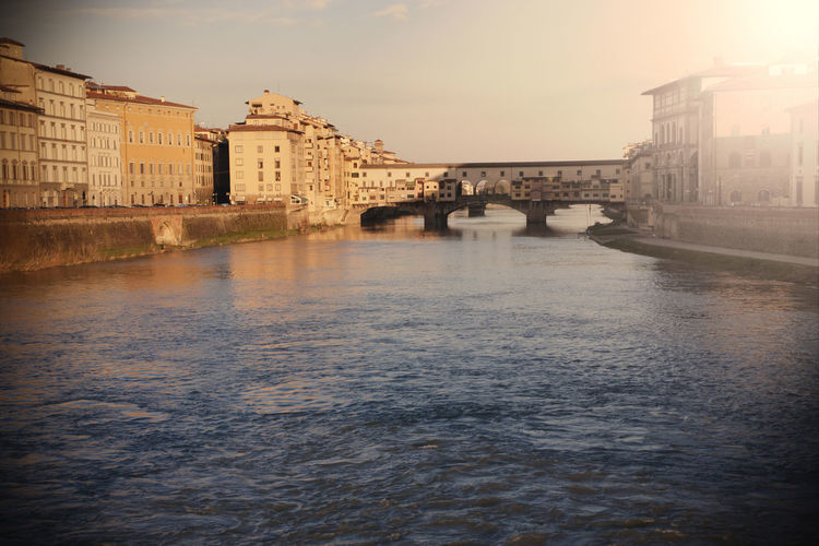 Ponte Vecchio in Florence at sunrise Ponte Vecchio Ponte Vecchio - Firenze Firenze Florence Arno  River Travel Destinations Landmark Famous Places Tuscany Italy Sunrise Colorful No People Architecture Built Structure Bridge - Man Made Structure Bridge Building Exterior Outdoors Sunset