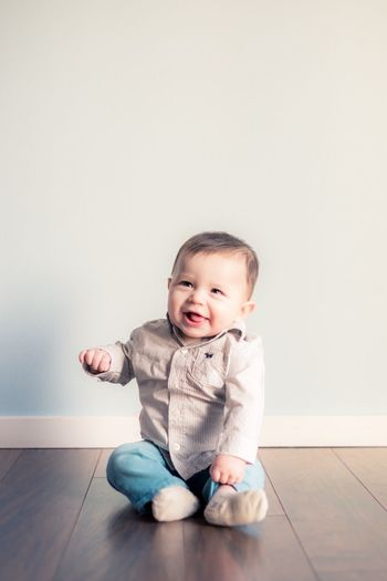 Six months old Childhood Development Sitting Up Six Months EyeEm Selects Baby Indoors  Full Length Cute Hardwood Floor Innocence Sitting One Person Babyhood Happiness Real People Looking At Camera Babies Only Portrait Smiling Childhood Home Interior Day People