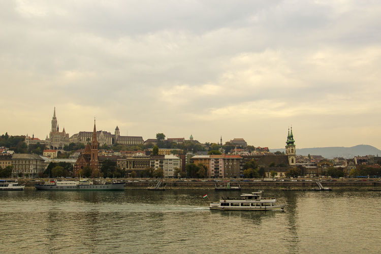 Amazing Landscapes of Budapest, Views of Hungary Architecture Nautical Vessel Building Exterior Built Structure Water Sky Transportation City Religion Mode Of Transportation Place Of Worship River Waterfront Cloud - Sky Building Belief Nature Travel Spirituality No People Cityscape Outdoors Passenger Craft Budapest Budapest, Hungary Budapest Streetphotography Budapest - Hungary Hungary Hungary I <3 You Hungary🇭🇺 Hungary Photos