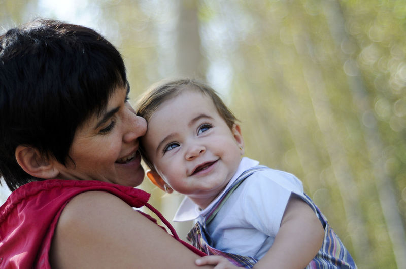Mother and daughter in the forest Daughters Mother Adult Bonding Child Childhood Daughter Emotion Family Family With One Child Females Headshot Innocence Love Mother Parent Portrait Positive Emotion Smiling Son Togetherness Women