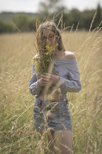 Country flowers Dress Eye4photography  Taking Photos Colors Freshness Face Modern Still Life Lifestyles Portrait Of A Woman Beauty Portrait People Contemporary Girl Fashion Nature Fashion Model Legs Foliage Cereal Plant Protection Sky Farmland Pollen Growing