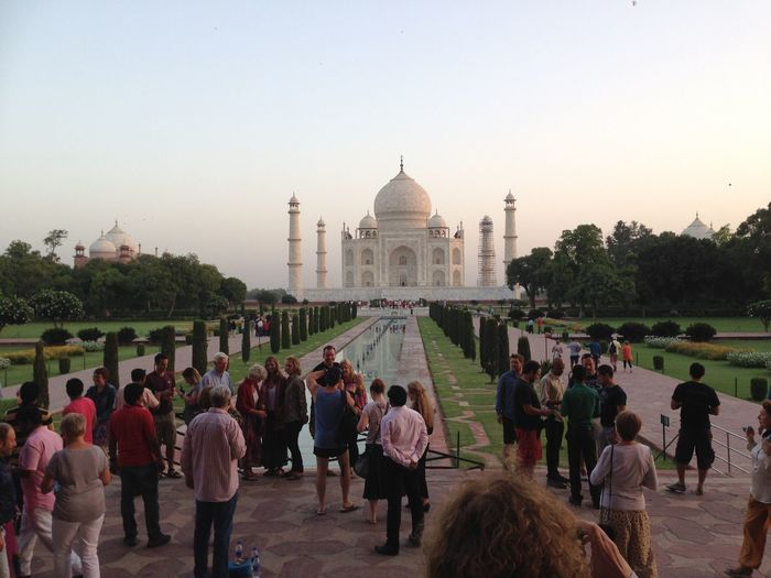 People Standing In Front Of Taj Mahal