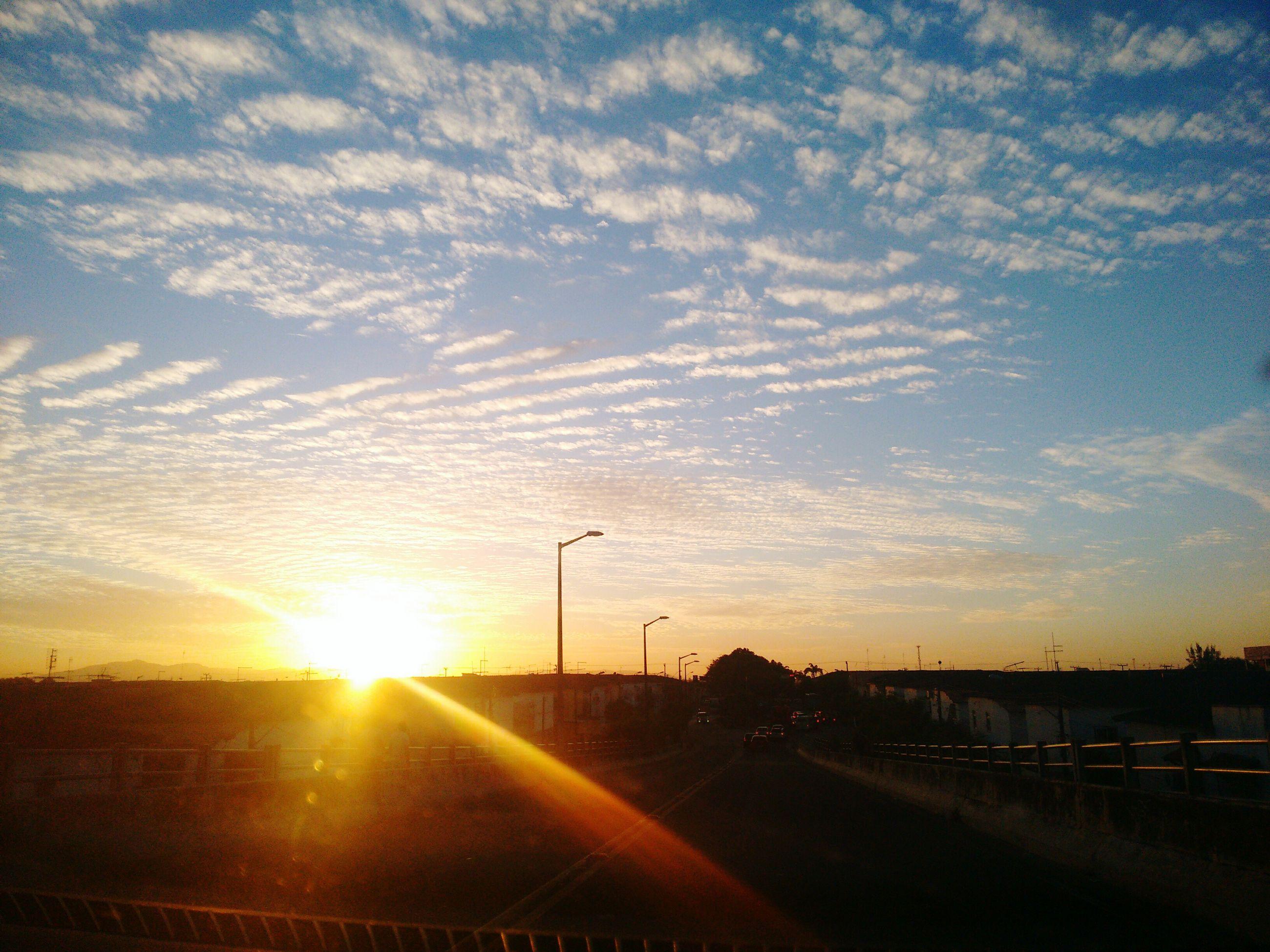 sunset, sun, sky, road, transportation, cloud - sky, no people, street light, silhouette, sunlight, car, scenics, nature, outdoors, beauty in nature, day