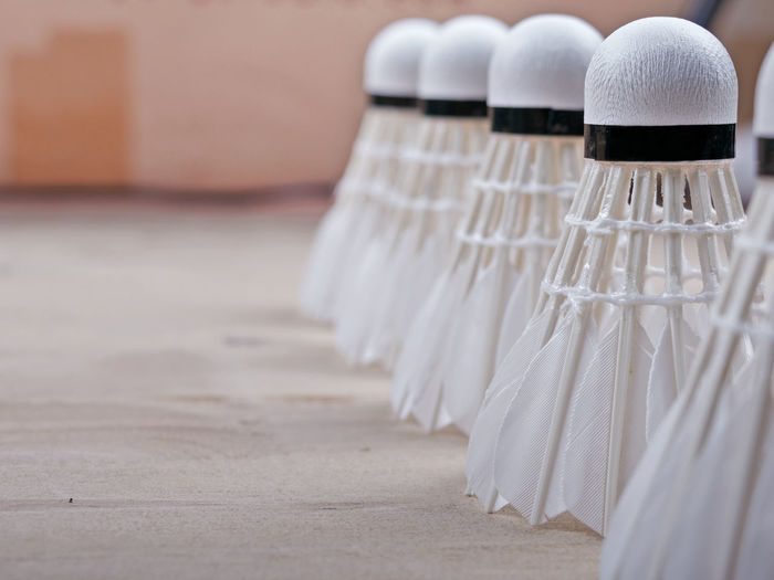 Close-up of shuttlecocks arranged on table