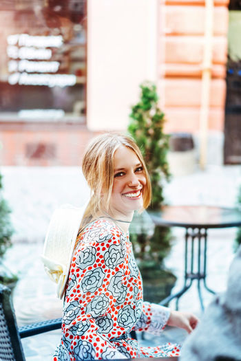 Smiling Happiness Blond Hair One Person Looking At Camera Portrait Emotion Hair Real People Women Lifestyles Day Waist Up Leisure Activity Casual Clothing Young Adult Females Architecture Teeth Hairstyle Outdoors Beautiful Woman Floral Pattern