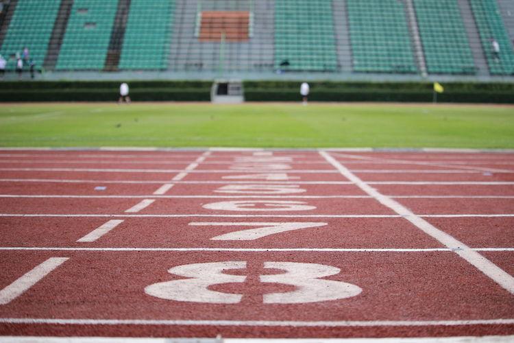 Starting line of running track at stadium