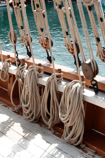 Ropes tied with pulley on boat