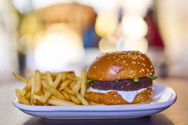 Bun Burger Close-up Day Deep Fried  Fast Food Focus On Foreground Food Food And Drink French Fries Freshness Hamburger Indoors  No People Plate Prepared Potato Ready-to-eat Table Unhealthy Eating