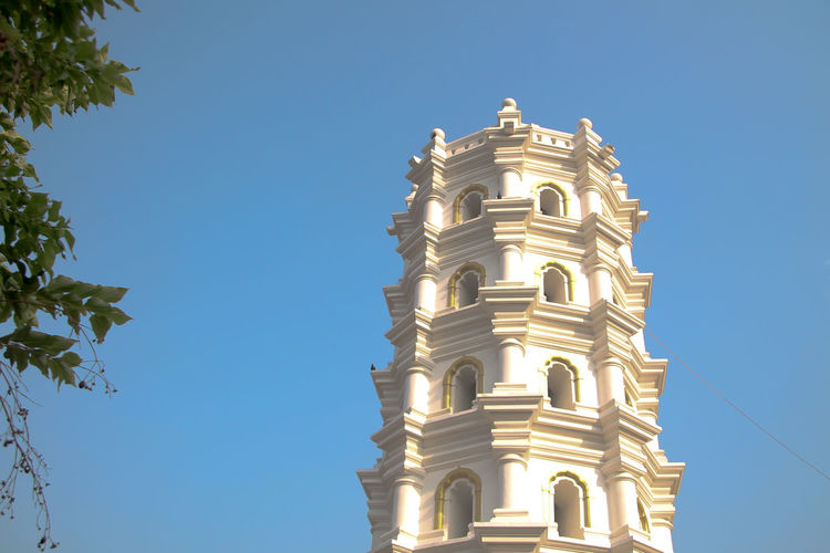 Architecture Bell Tower Blue Building Exterior Built Structure Clear Sky Day History Light Stand Lighthouse Low Angle View Nature No People Outdoors Place Of Worship Religion Sky Spirituality Sunlight Temple Tree