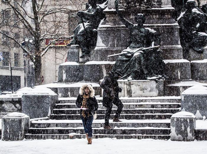 Full length of man on snow in city
