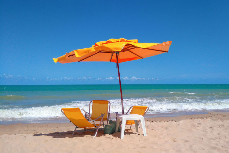 Beach Beauty In Nature Blue Chair Clear Sky Day Horizon Over Water Nature No People Outdoors Sand Scenics Sea Shore Sky Summer Tranquil Scene Tranquility Vacations Water Yellow Summer Exploratorium