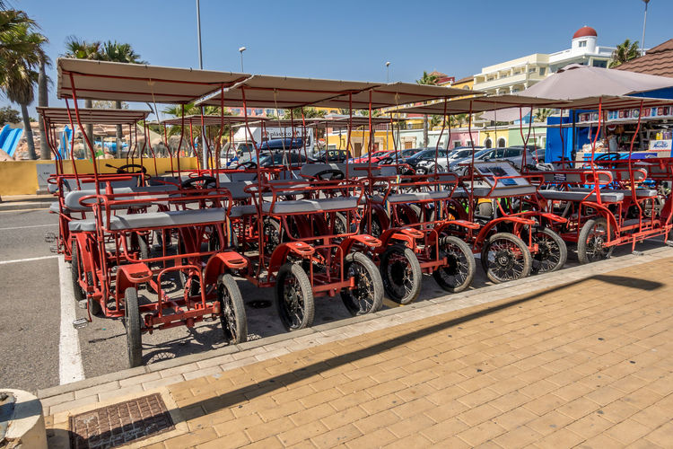 Transportation Mode Of Transportation Land Vehicle Architecture Building Exterior City Built Structure Day Street Motor Vehicle Outdoors Sunlight No People Car In A Row Red Nature Road Sky Almería SPAIN