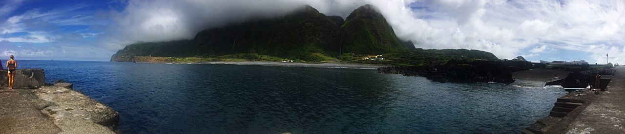 A Day At The Beach Water Panoramic Tranquil Scene Tranquility Mountain Scenics Sea Beauty In Nature People And Places. Cloud - Sky Non-urban Scene Sky Remote Solitude Waterfalls Majestic Waterfront Outdoors Mountain Range Day Swimmingsuit Cheeky Girl Misty Faja Grande Flores Island