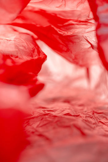 Extreme macro inside plastic bag abstract background End Plastic Pollution Plastic Bag Trash Abstract Backgrounds Close-up Crumpled Extreme Close-up Freshness Full Frame Garbage Inside Intensive Red Litter Macro Pattern Plastic Pollution Red Rubbish Mountains Selective Focus Sharp Still Life Textured  Vibrant