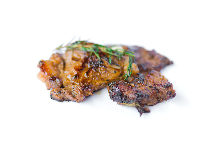 Close-up of meat on white background