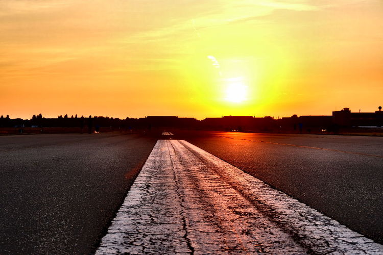 View of empty road at sunset
