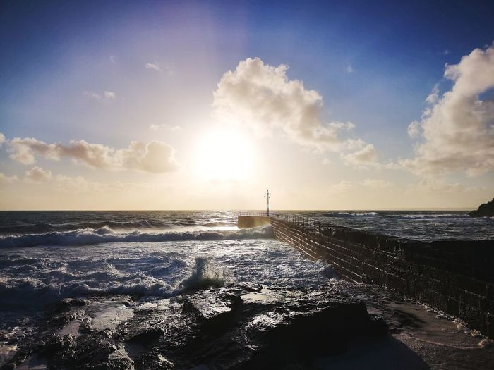 Porthleven breakwater on a warm February day Harbour Porthleven Harbour Cornwall Seaside_collection Travel Britain EyeEm Explore Cornwall Harbourside Cloud - Sky Landscape_Collection February 2019 Water Sea Beach Sunset Sunlight Sand Sun Silhouette Blue Seascape Tide Wave Rushing Coastal Feature Crashing