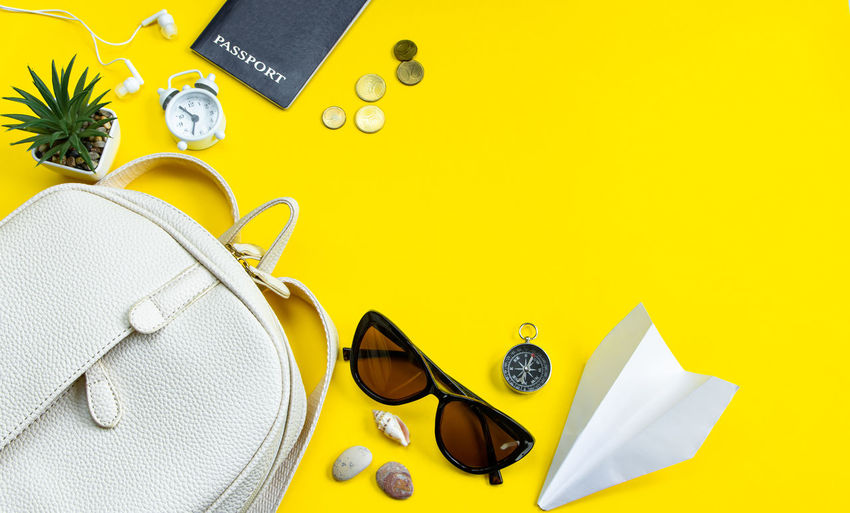 Close-up of sunglasses on table against yellow background