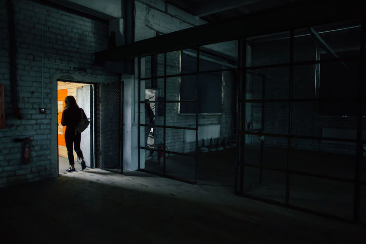 Woman exiting building