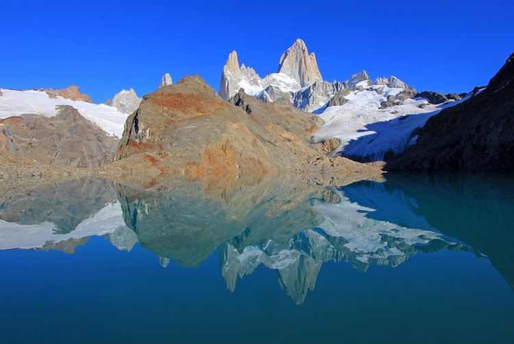 Beautiful reflection of Mt Fitz Roy, Laguna de Los Tres in Los Glaciares National Park, Patagonia, Argentina, South America Patagonia Argentina El Chalten Chalten Reflection Glacier Glacial Glaciers Lake Fitzroy Fitz Roy Landscape Nature Snow Water Wilderness Trekking Mountaineering Hiking Mountain Mountain Range Snowcapped Tres Laguna Lagoon