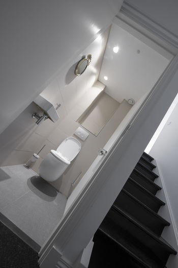 Indoors  Staircase Steps And Staircases Home Bathroom No People Architecture Domestic Room Modern Lighting Equipment Illuminated Absence Hygiene Railing Home Interior Ceiling Low Angle View White Color Domestic Bathroom Clean Luxury Toilet Toilet Paper Wc