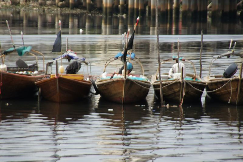 Boats moored in a lake