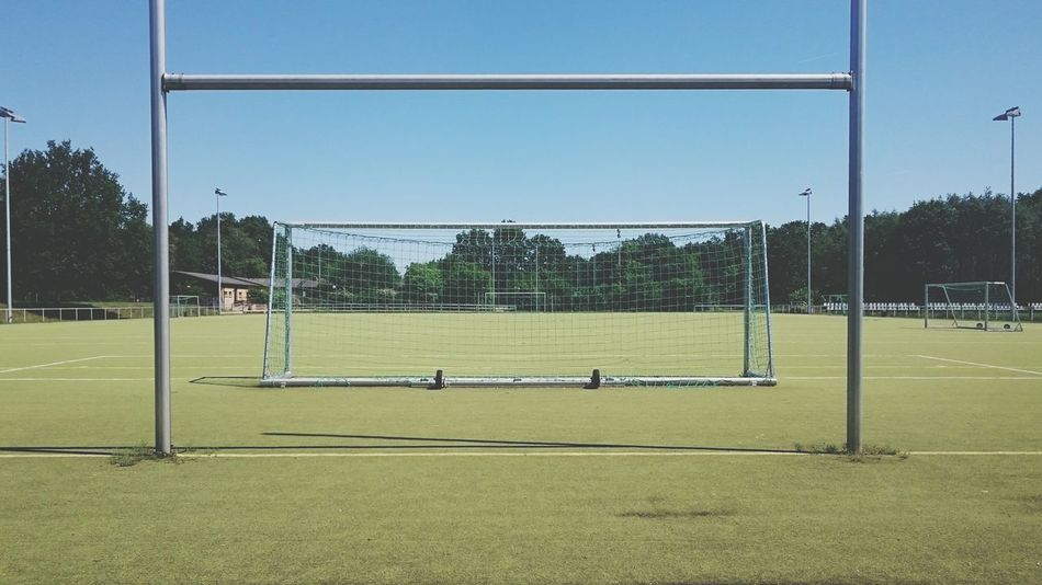 Football Fever Empty pitch. Football Pitch Sports Photography Geometry Vertical Symmetry Smartphone Photography Berlin Sportplatz Green And Blue Pastel Power Pastel Colors Narure